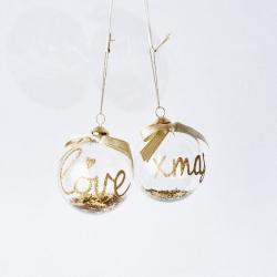 2 doorzichtige ballen met goud