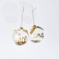 2 transparent baubles with gilding