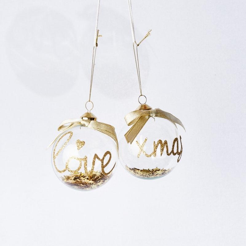 Boule en verre transparente, écriture dorée et paillettes